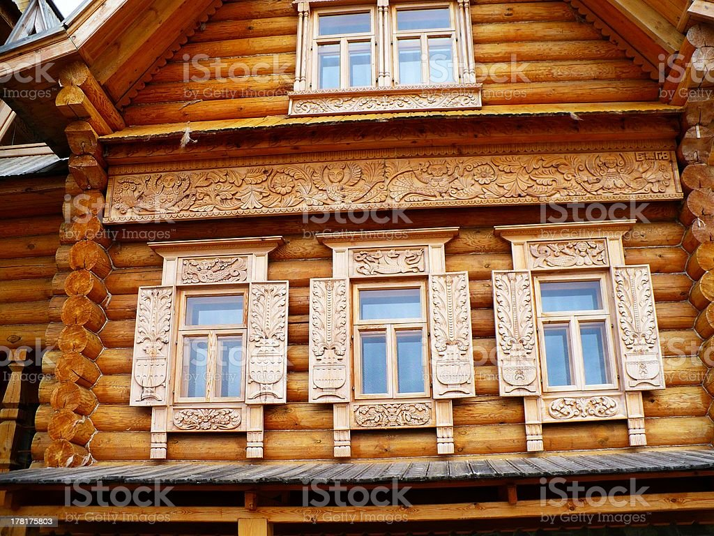 Three wooden windows with delicate shutters royalty-free stock photo