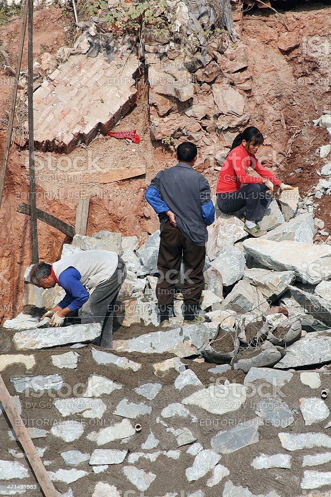 Tre lavoratori, Cina foto stock royalty-free
