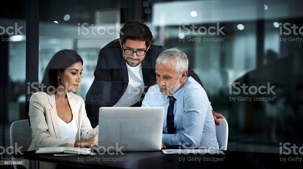 Three working as one successful unit stock photo
