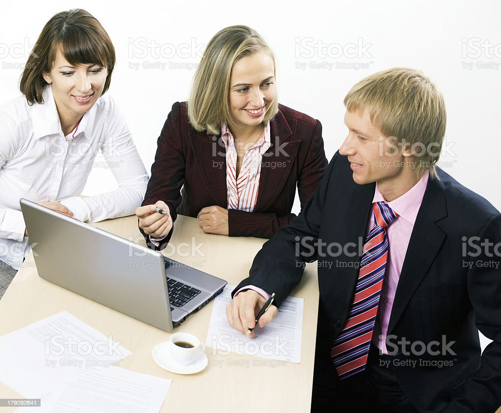 Three working businesspeople royalty-free stock photo