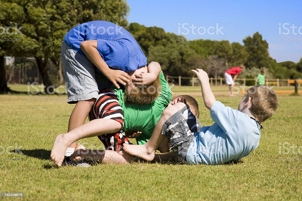 Three Wrestling Boys stock photo