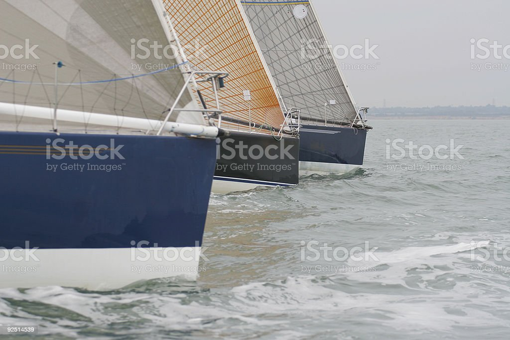 Three Yachts Sailing Close To Each Other royalty-free stock photo