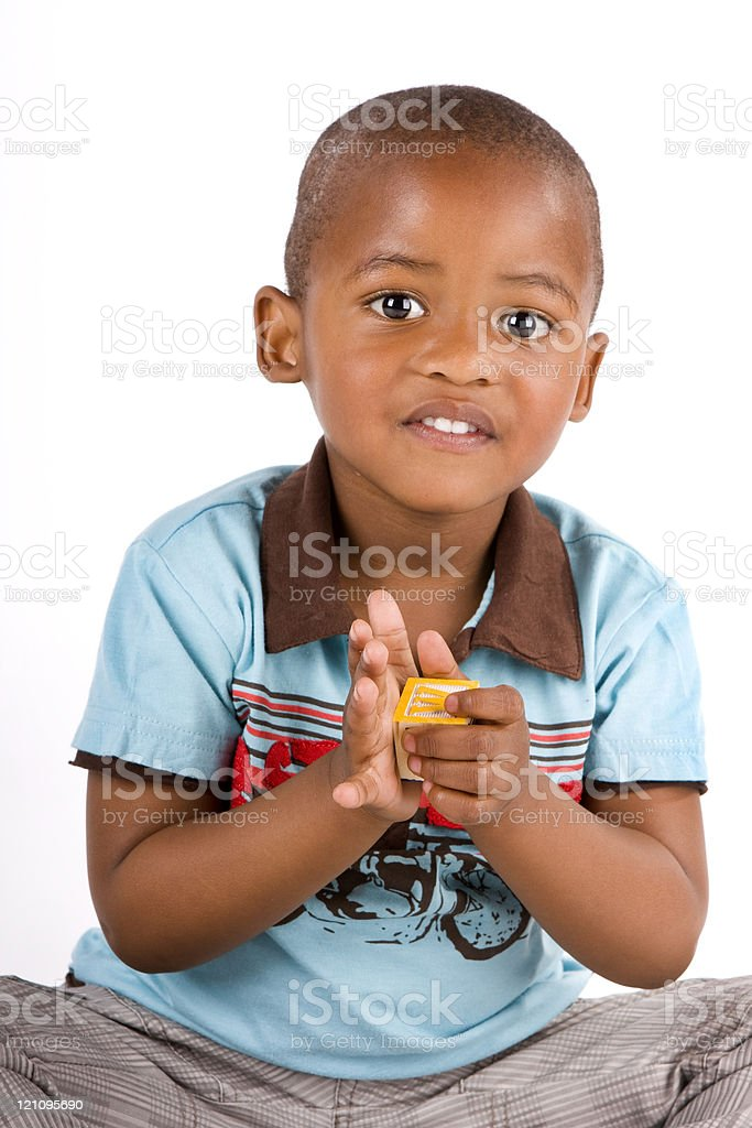 Three year old black boy playing with blocks stock photo
