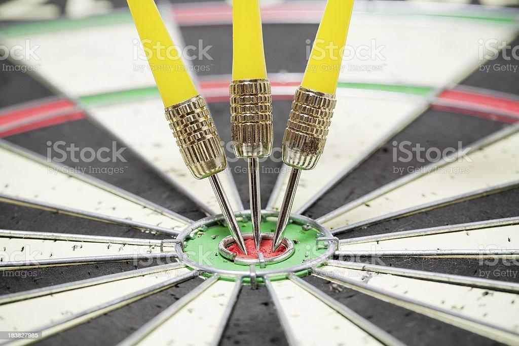 Three yellow darts in dartboard  bullseye royalty-free stock photo