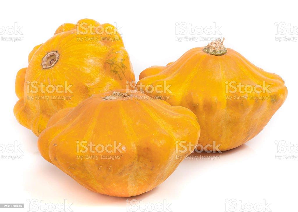 three yellow pattypan squash isolated on white background stock photo