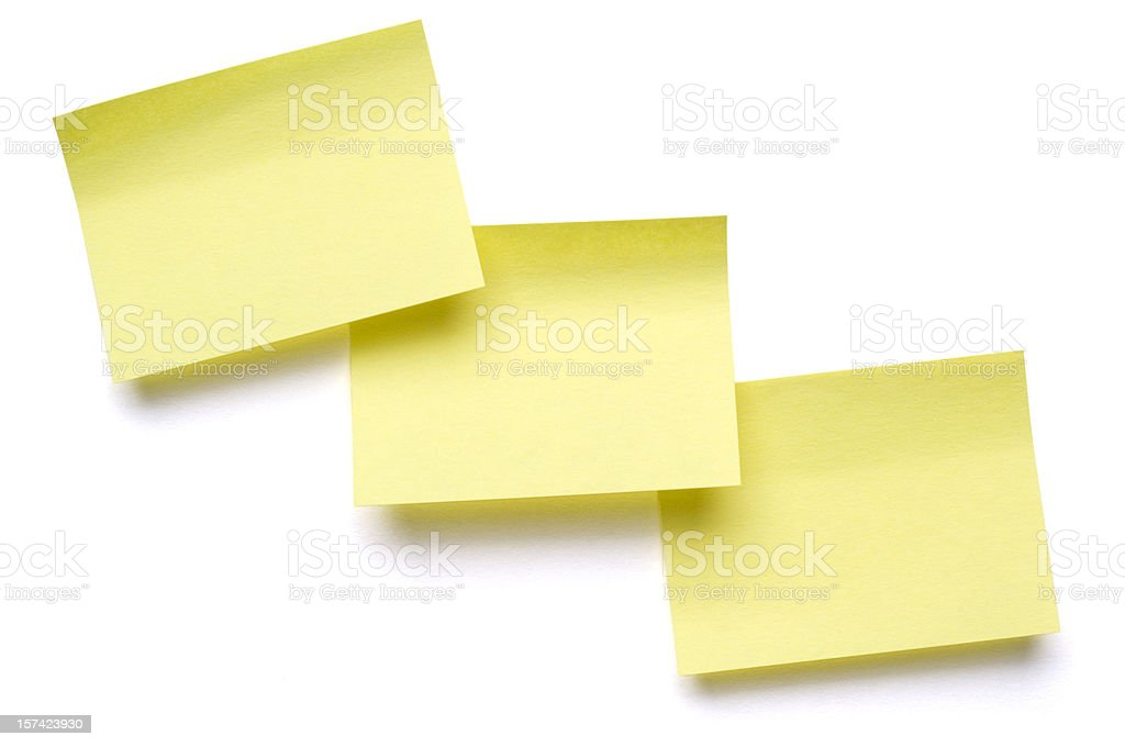 Three yellow Post-it Notes on white royalty-free stock photo