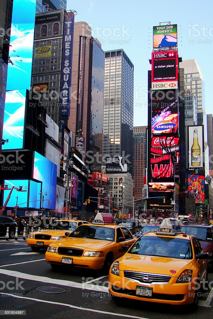 Three Yellow taxi Times Square stock photo