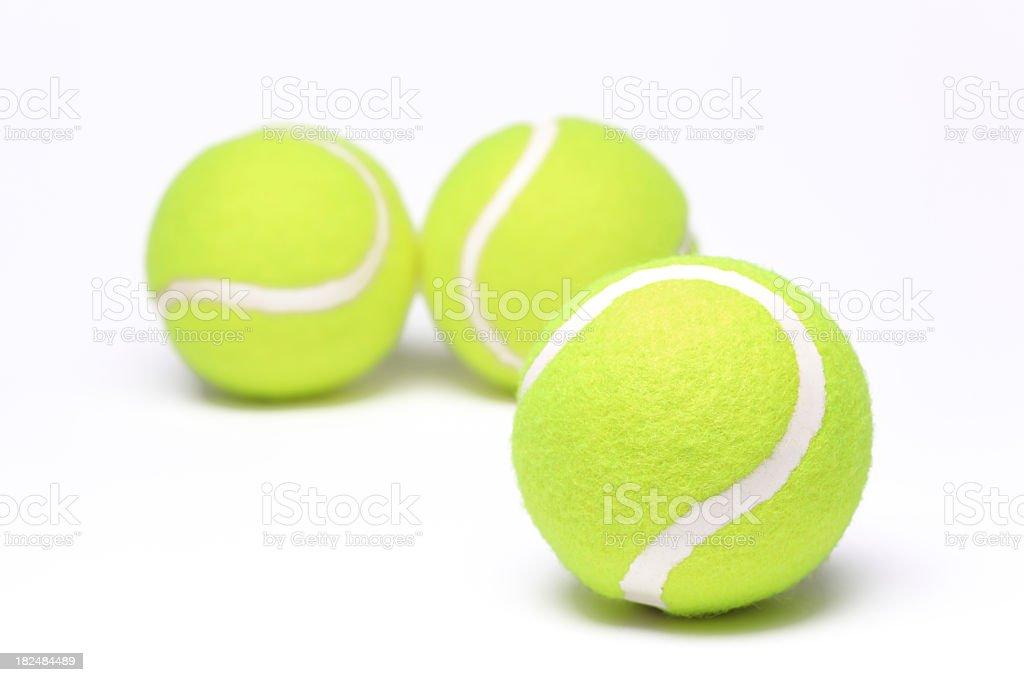 Three yellow tennis balls on a white background royalty-free stock photo