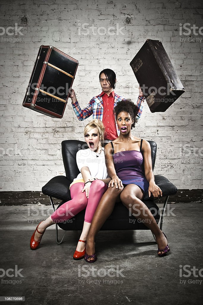 Three Young Adults Posing  in Chair royalty-free stock photo