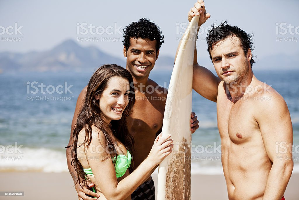 Three young brazilian surfers at the beach royalty-free stock photo
