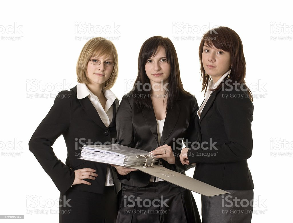 three young businesswomen with ring binder stock photo