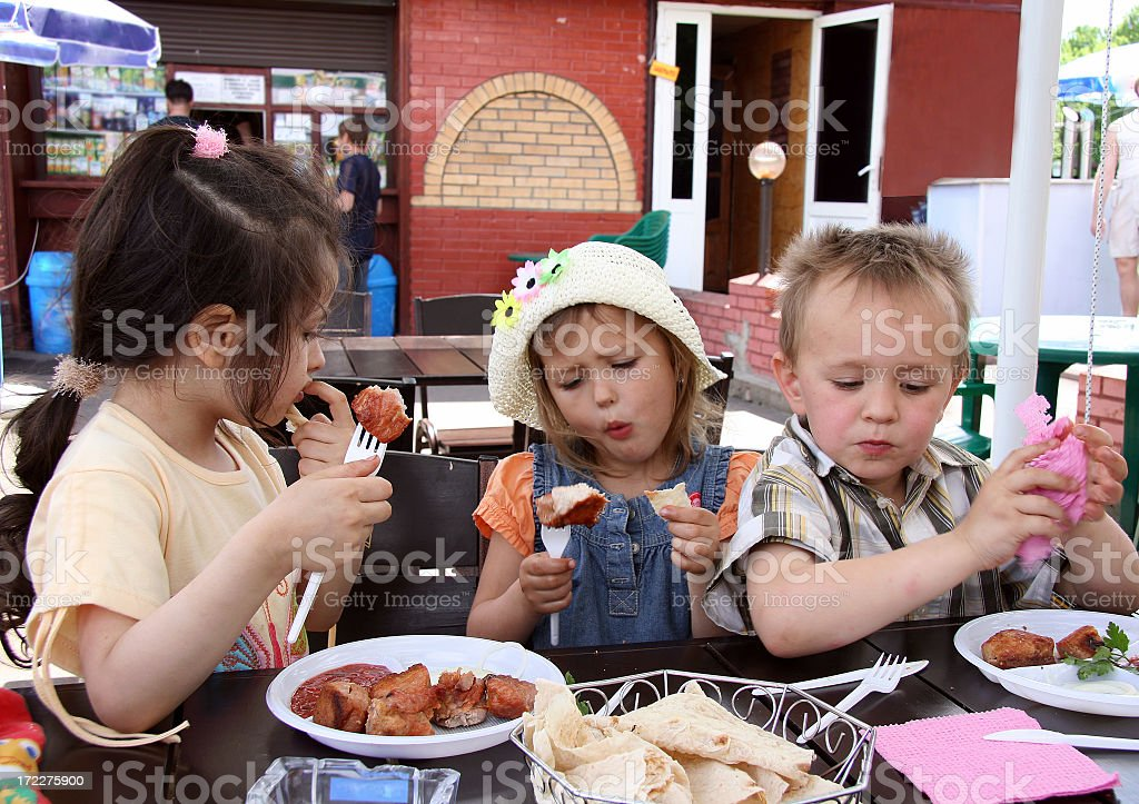 Three young Caucasian children in a cafee royalty-free stock photo