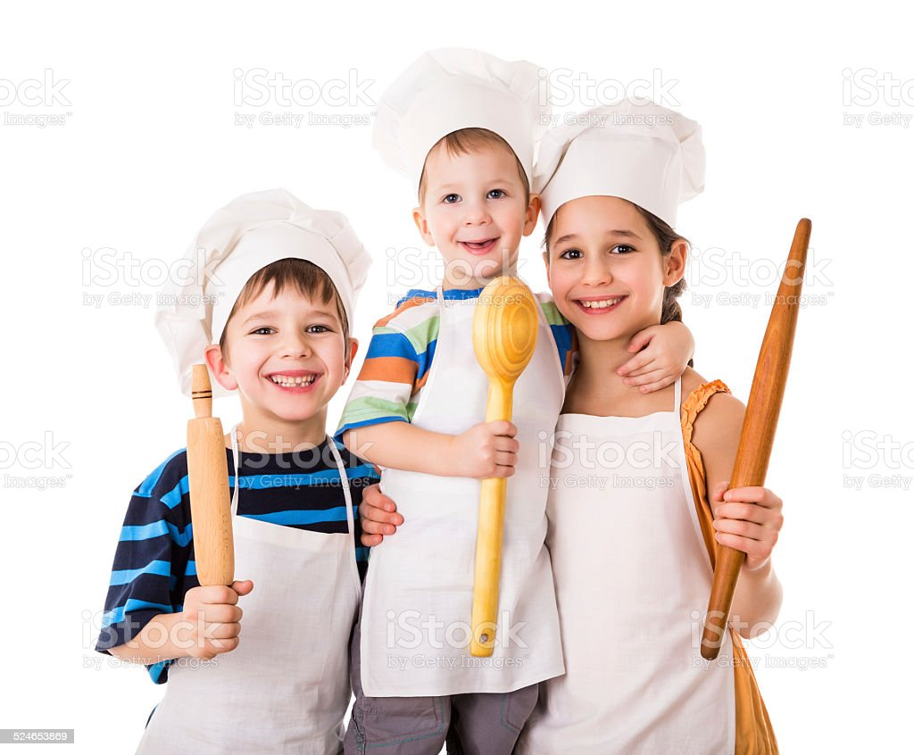Three young chefs with ladle and rolling pin stock photo