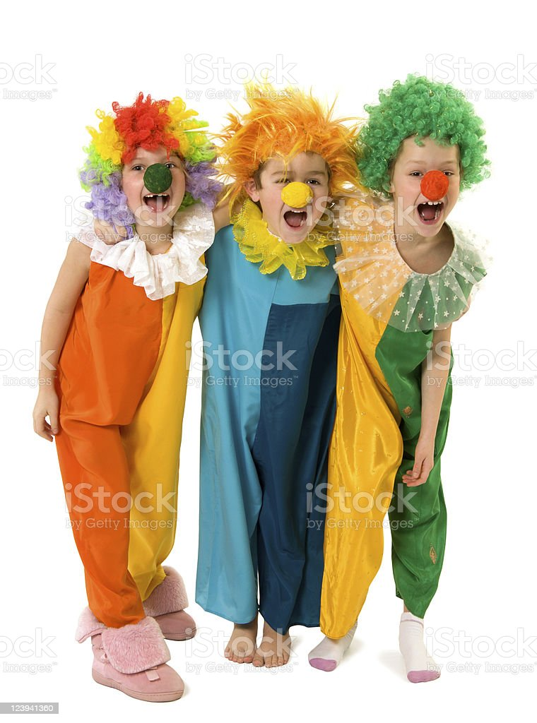 Three young children dressed up as clowns royalty-free stock photo