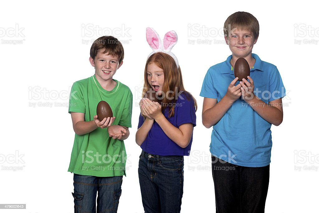 three young children holding easter eggs stock photo