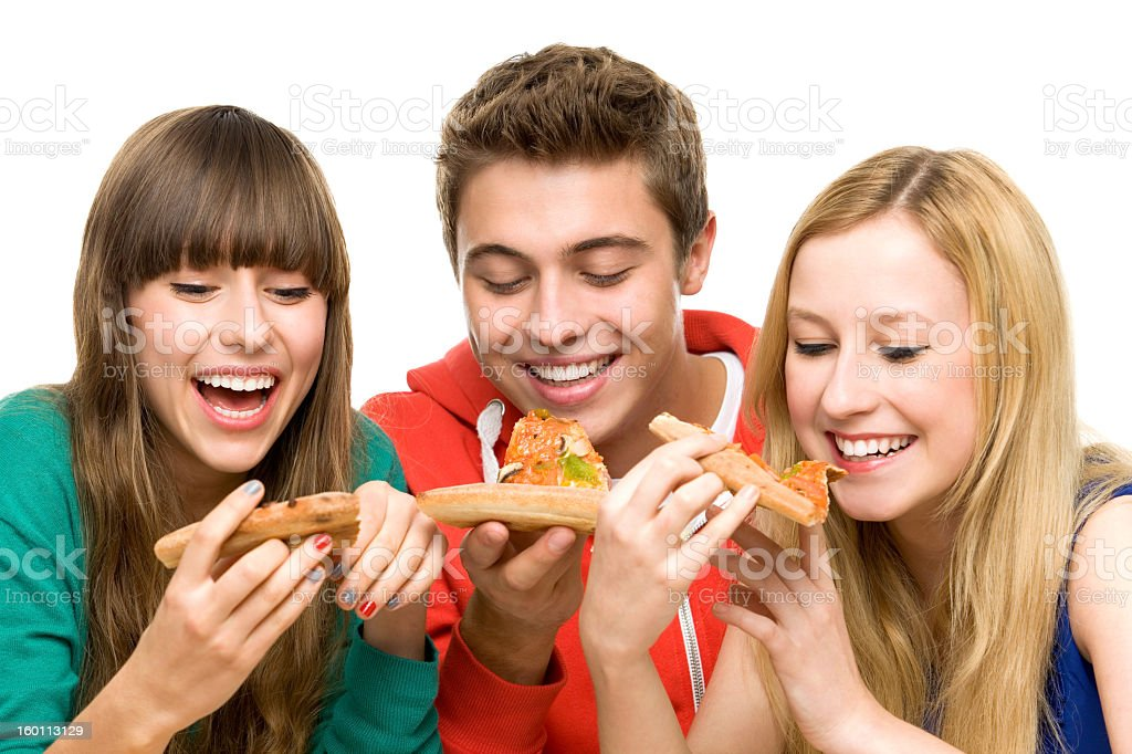 Three young friends eating pizza royalty-free stock photo
