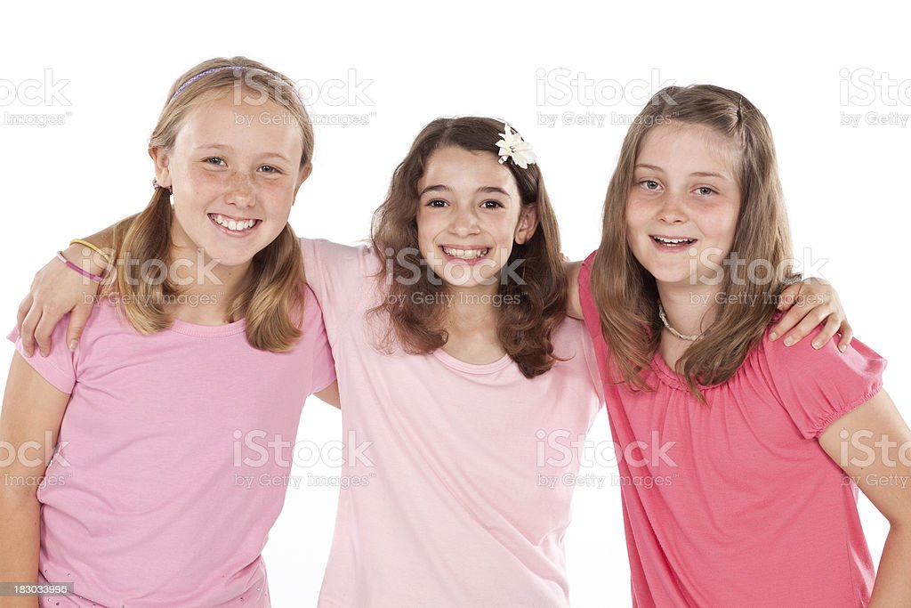 Three young girl friends isolated on white. royalty-free stock photo