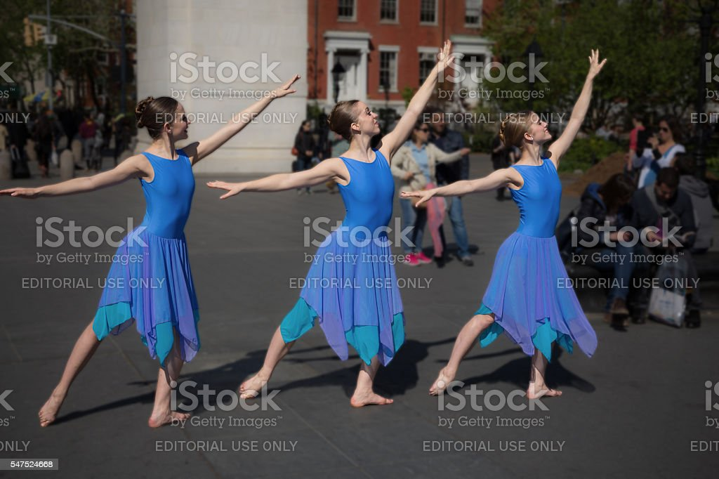 Three Young Girls Dancers in Washington Square Park, Manhattan, NYC. stock photo