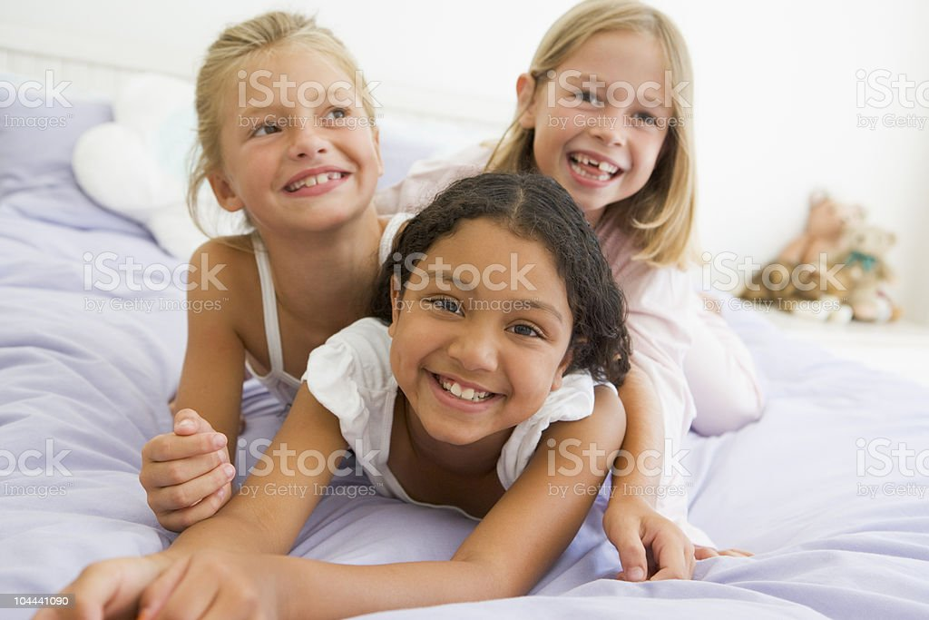 Three Young Girls In Their Pajamas stock photo