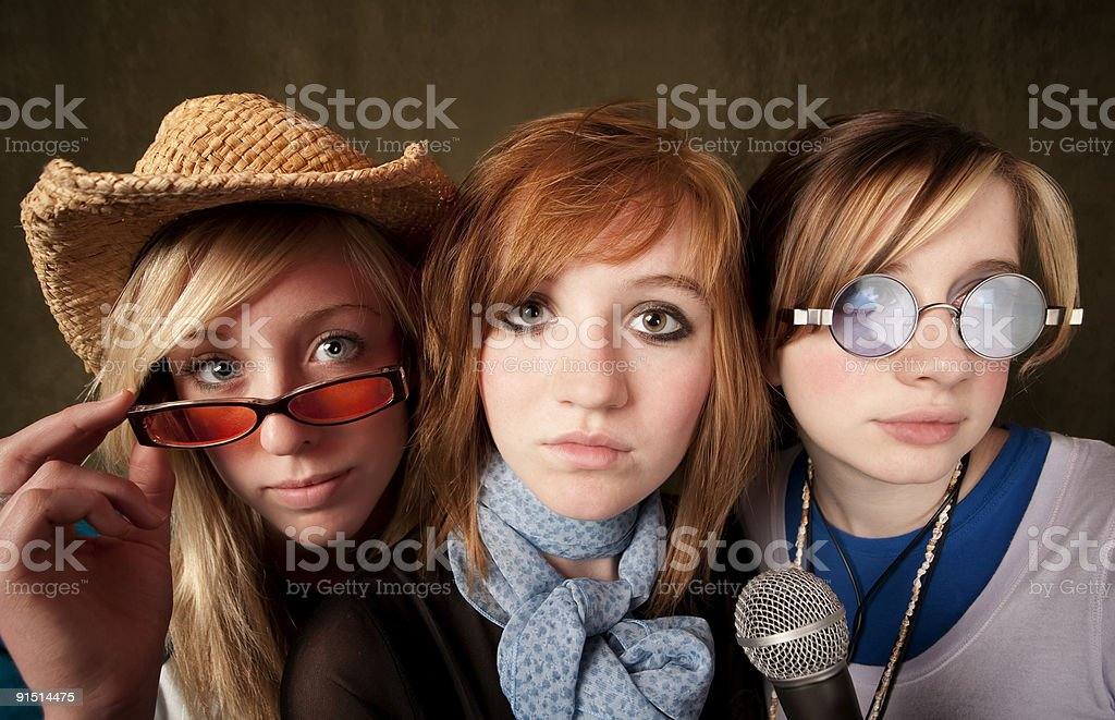 Three Young Girls with Microphone royalty-free stock photo