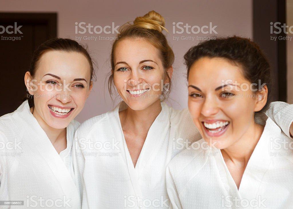 Three young happy women at spa resort stock photo