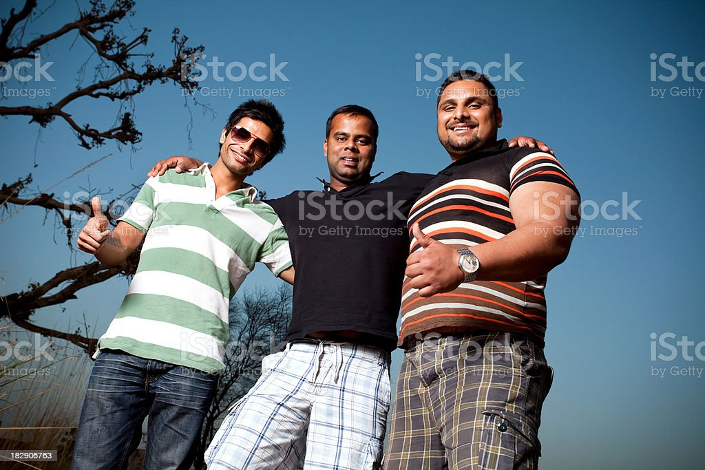Three Young Indian Asian Male Friends with thumbs up sign royalty-free stock photo