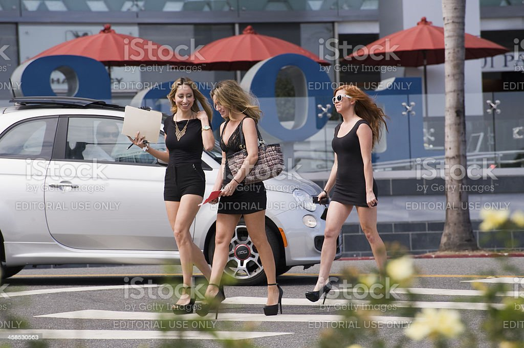 three young ladies crossing the street royalty-free stock photo