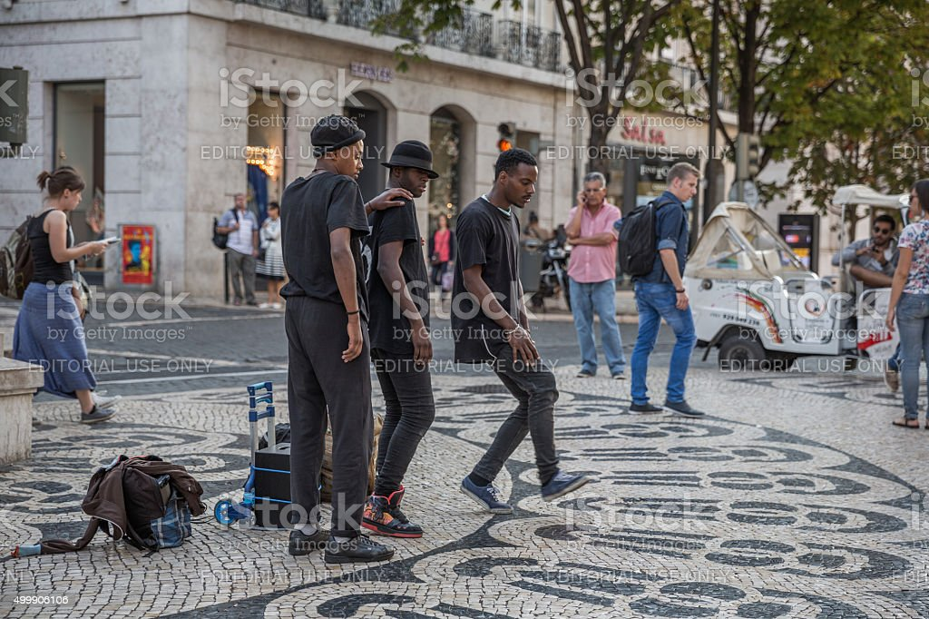 Three young men entertaining the public, Lisbon, Portugal stock photo