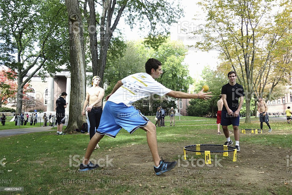 Three young men playing spike ball stock photo