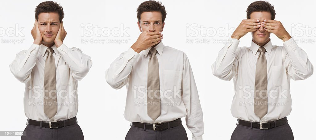 Three young men standing with hands on ear, mouth, eyes royalty-free stock photo