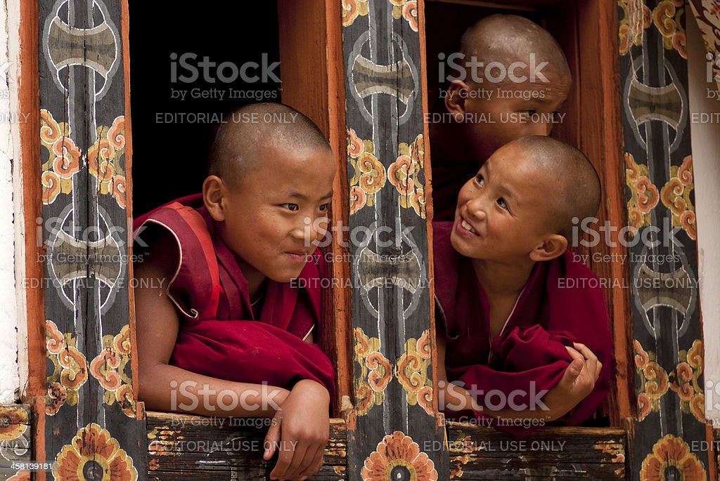 Three young monks in Bhutan stock photo