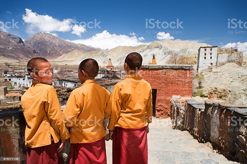 Three young Novice monks in Tibetan monastery, Upper Mustang stock photo