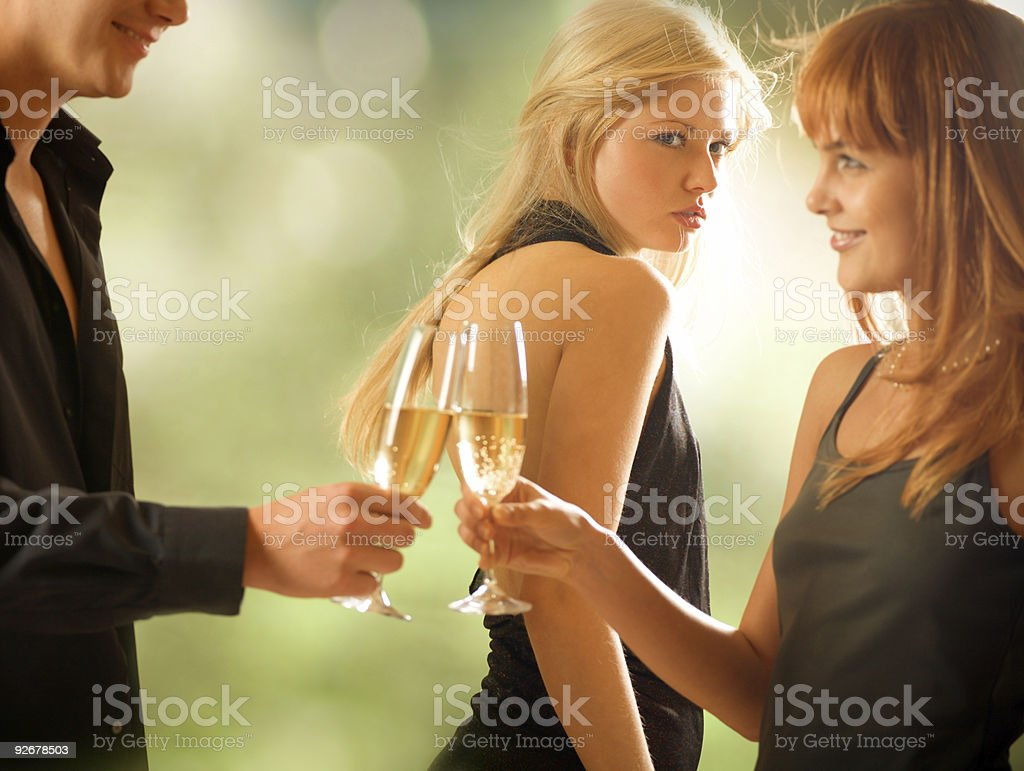 Three young people drinking, outdoors stock photo