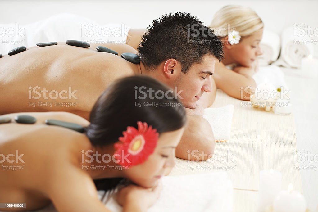 Three young people enjoying in the spa treatments. royalty-free stock photo