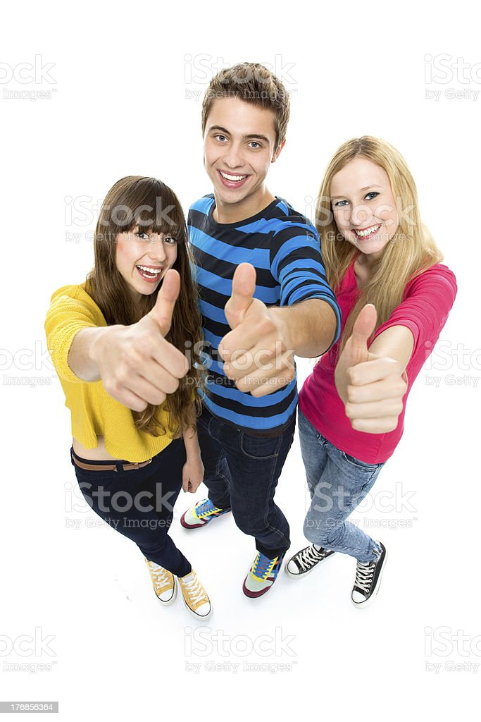 Three young smiling friends with thumbs up royalty-free stock photo