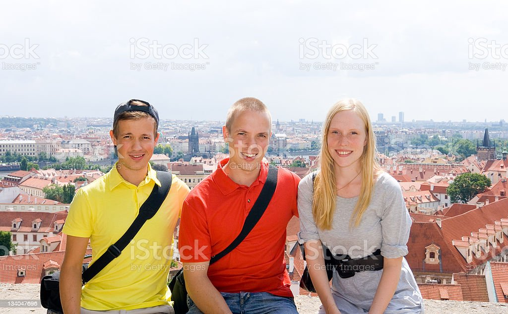 Three young tourists in Prague royalty-free stock photo