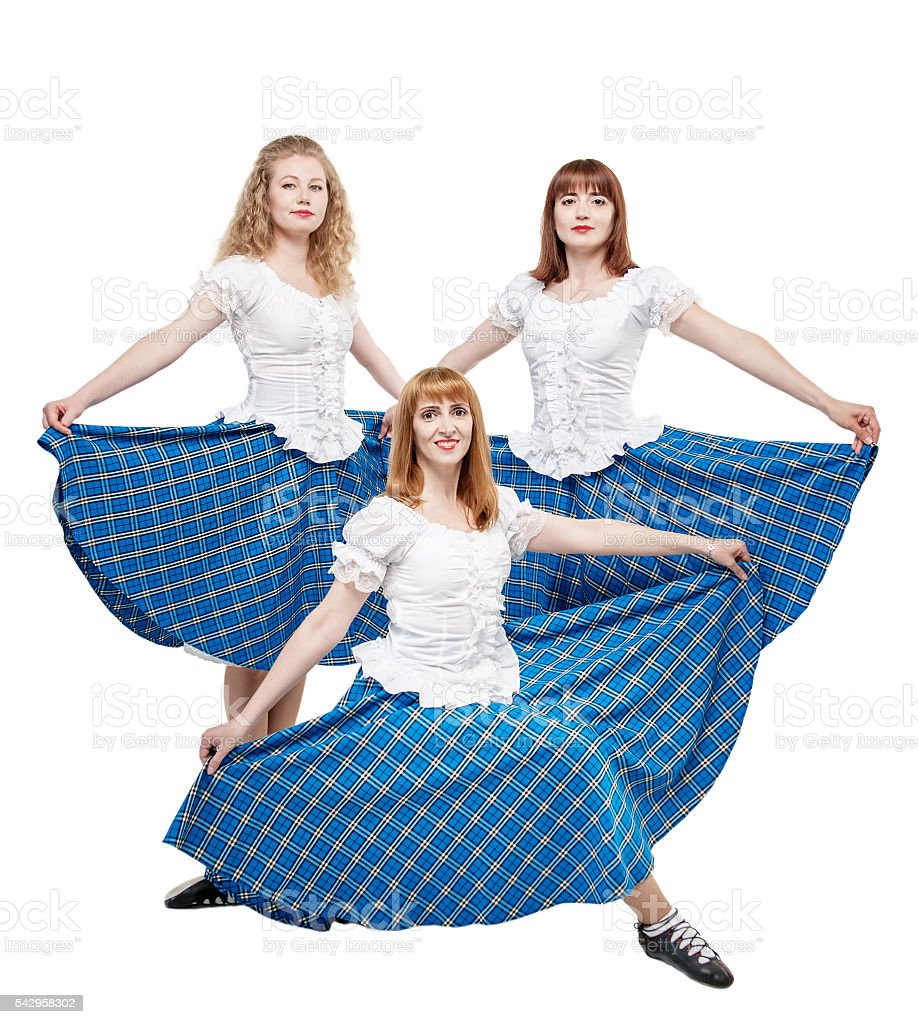 Three young woman in clothing for Scottish dance stock photo