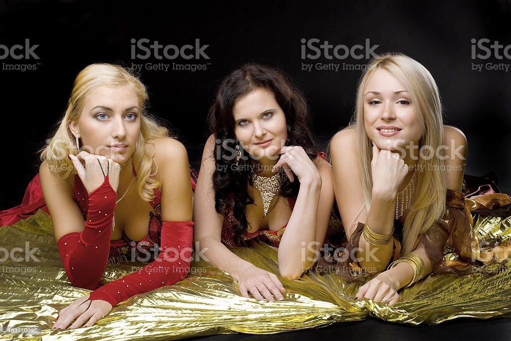 Three young woman  on gold wing royalty-free stock photo