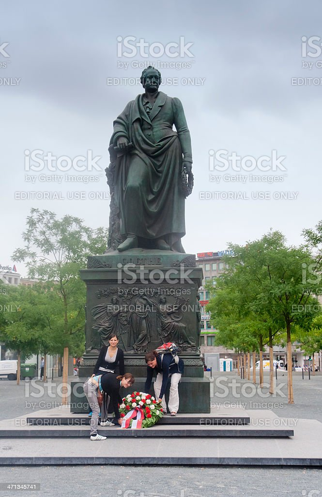 Three young women and Goethe statue in Frankfurt, Germany stock photo
