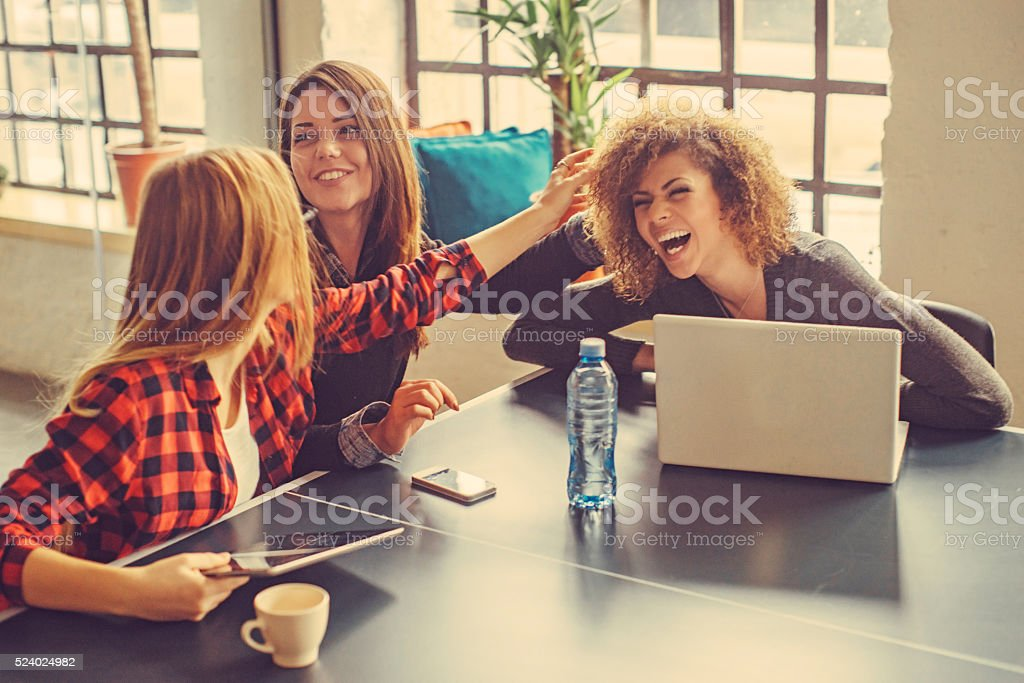 three young women at the office stock photo