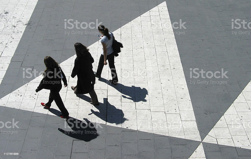 Three young women crossing Sergels Torg in Stockholm royalty-free stock photo