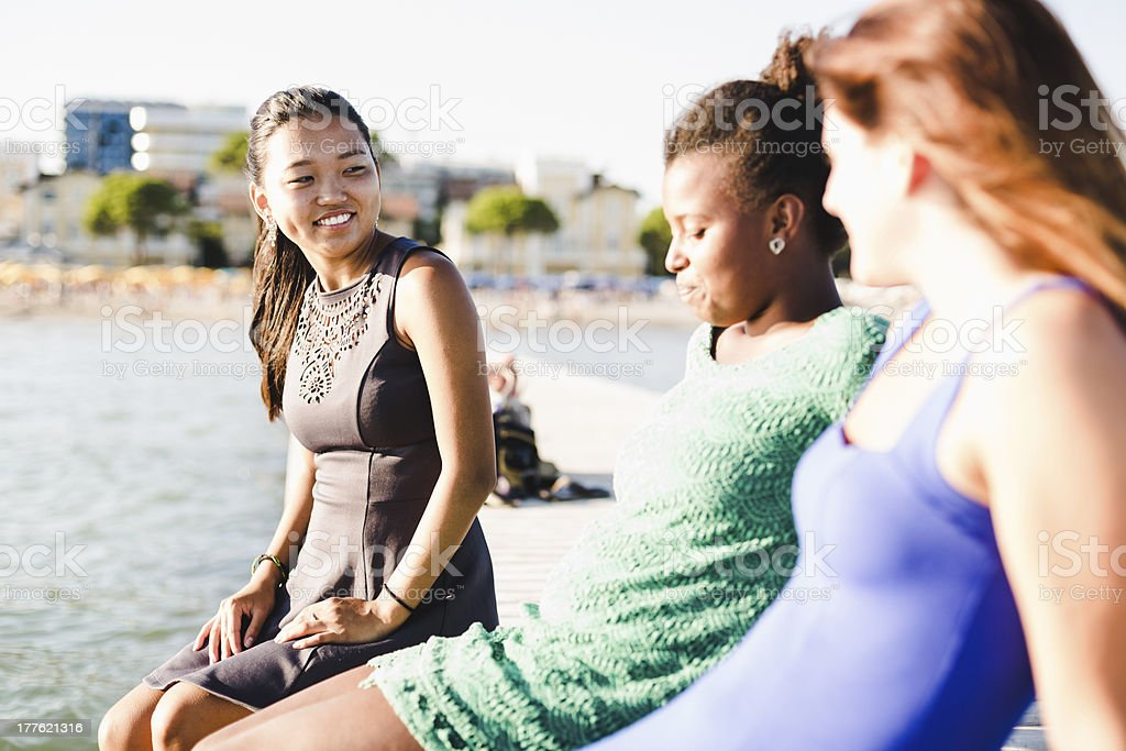 Three young women having fun at sunset royalty-free stock photo