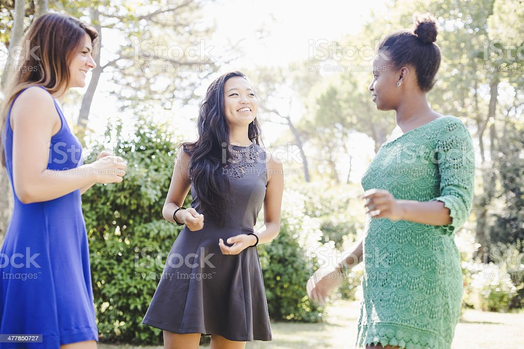 Three young women having fun at the park royalty-free stock photo