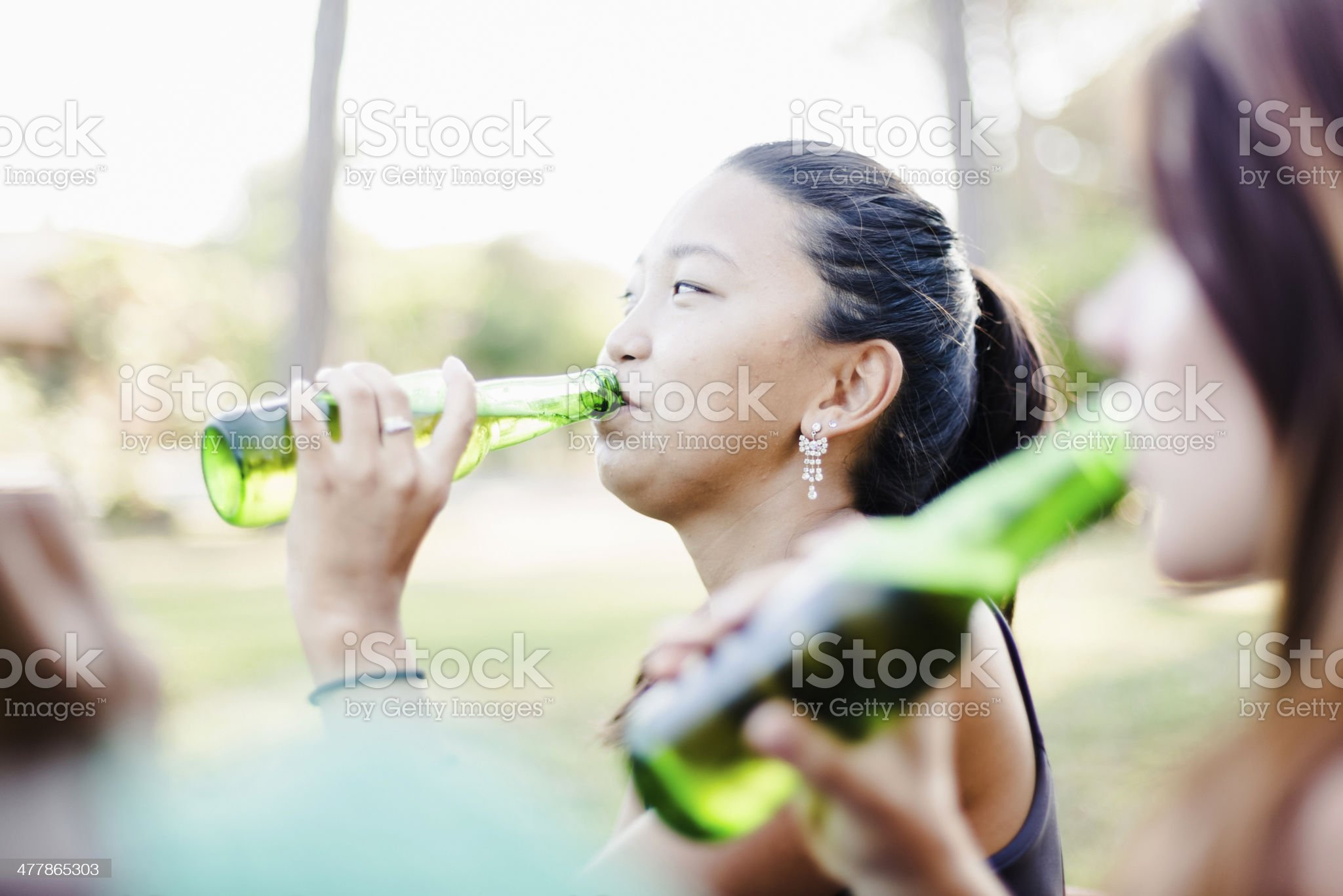 Three young women relaxing at the park royalty-free stock photo