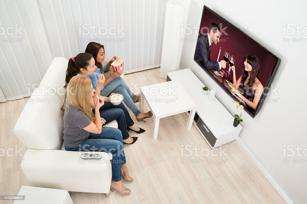 Three Young Women Watching Movie stock photo