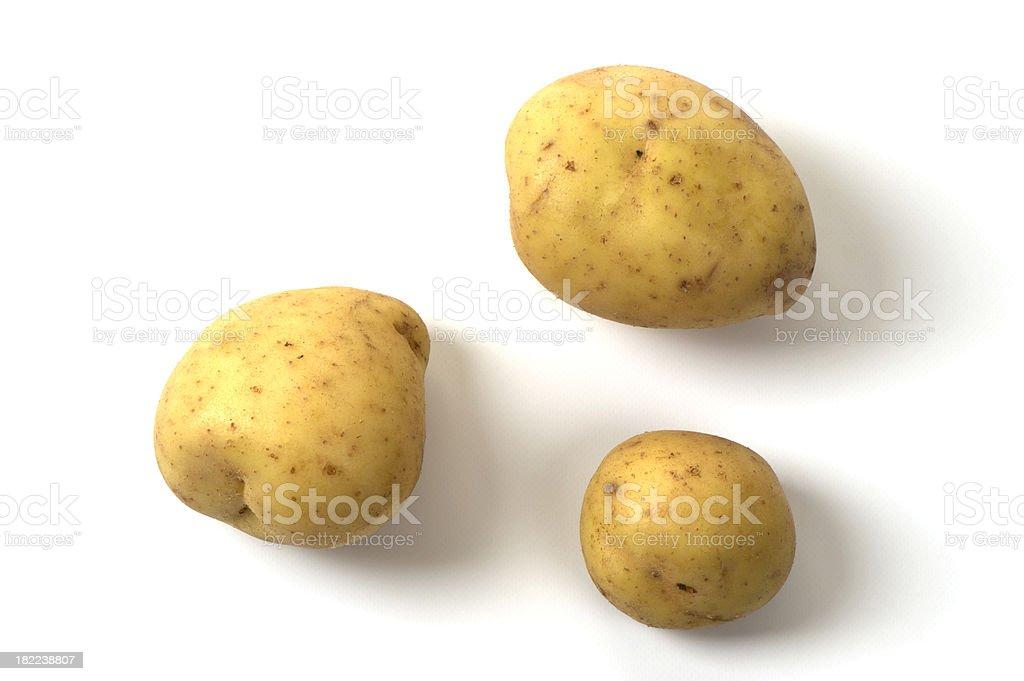Three Yukon Gold potatoes on white background royalty-free stock photo