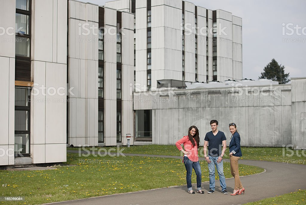Threee students in front of university stock photo
