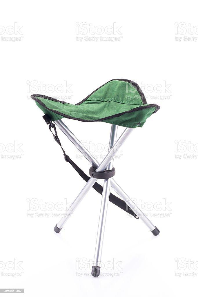 Three-legged tourist portable chair stock photo