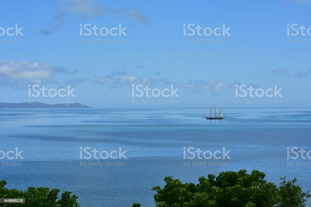 Three-masted sailship on calm sea stock photo