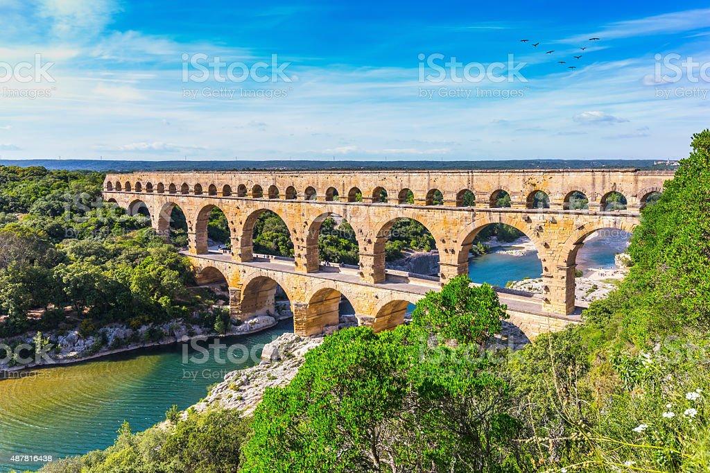 Three-tiered aqueduct Pont du Gard and natural park stock photo
